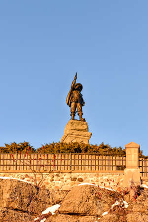The statue of Samuel de Champlain with astrolabe navigation instrument in Ottawa, Canada.