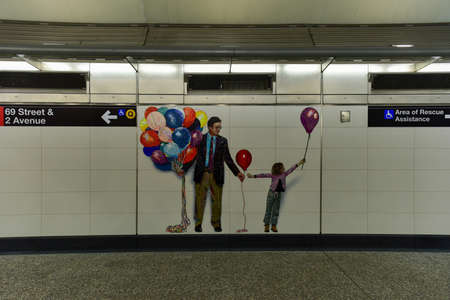 New York City - February 11, 2017: Art installation at 72nd Street subway station on Second Avenue in New York City, New York. Mosaics designed by Vik Muniz called Perfect Strangers. Banco de Imagens - 75124273