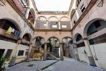 Old building in the process of collapsing in the Old Havana neighborhood of Havana, Cuba.