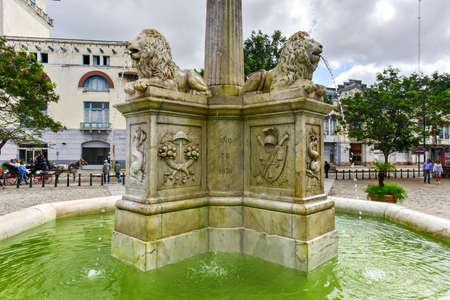 Havana, Cuba - Jan. 8, 2017: Lions Fountain in San Francisco Plaza in Old Havana, a famous touristic landmark in the colonial city.