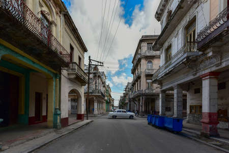 Classic Car driving in the streets of Old Havana, Cuba.