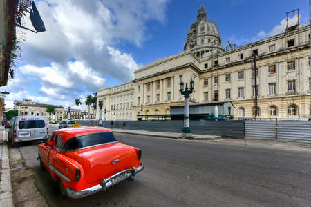 dirty car: Havana, Cuba - January 8, 2017: Cars parking in the front of the National Capital Building (El Capitolio) in Havana, Cuba. Editorial