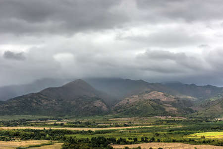 quite: Panoramic view over the fields of Trinidad, Cuba. Stock Photo