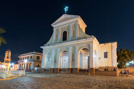 Holy Trinity Church in Trinidad, Cuba. The church has a Neoclassical facade and is visited by thousands of tourists every year.