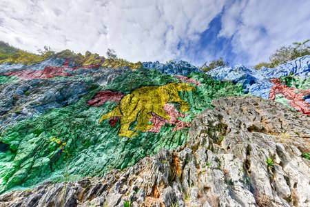 Mural de la Prehistoria, a giant mural painted on a cliff face in the Vinales area of Cuba. It is 120m long and took 18 people 4 years to complete.