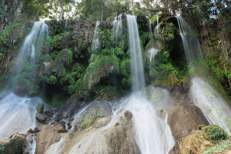 sierra: El Nicho Waterfalls in Cuba. El Nicho is located inside the Gran Parque Natural Topes de Collantes, a forested park that extends across the Sierra Escambray mountain range in central Cuba.