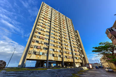 frequent: The Giron Tower of 1967 is among the most sophisticated apartment complexes of the early revolutionary period of Havana. There are now frequent power failures and the elevator does not work many days. Stock Photo