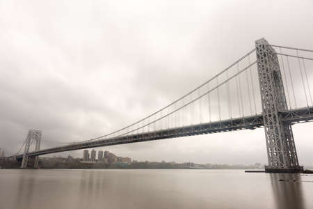 George Washington Bridge crossing the Hudson River on a overcast cloudy day from Fort Lee, New Jersey. Stock fotó