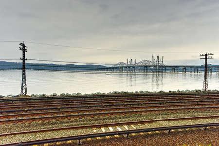 The new Tappan Zee bridge under construction across the Hudson River in New York across train tracks. Stock Photo