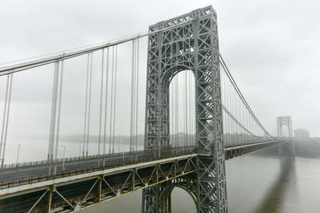 George Washington Bridge crossing the Hudson River on a overcast cloudy day from Fort Lee, New Jersey. Stock Photo