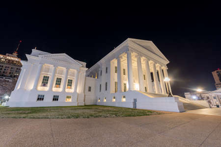 The Virginia State Capitol at night. Designed by Thomas Jefferson who was inspired by Greek and Roman Architecture in Richmond, Virginia. Stock Photo