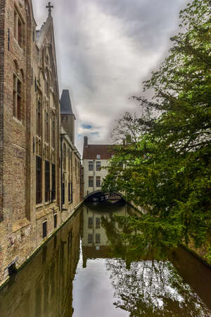 View from the famous medieval St Bonifacius Bridge in historic center of Bruges, Belgium. Stock Photo - 80485993