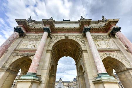 Triumphal Arch (Arc de Triomphe du Carrousel) at Tuileries gardens in Paris, France. Monument was built between 1806-1808 to commemorate Napoleons military victories. Stock Photo