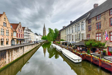 Canals of Bruges, Belgium with the Church of our Lady in the background