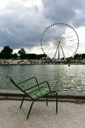 most popular: Ferris Wheel by Tuileries Garden in Paris, France. It is one of the oldest and most popular places in the center of Paris in the 1st district, on the right bank of Seine. Stock Photo