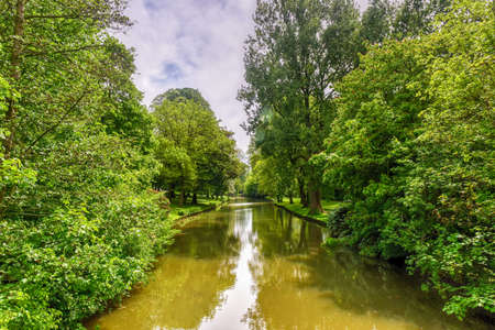 Minnewaterpark and Minnewater lake in the old city of Bruges, Belgium. Stock Photo