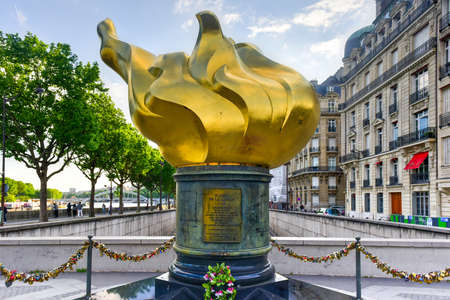 The Flame of Liberty in Paris is a full-sized, gold-leaf-covered replica of the new flame at the upper end of the torch of the Statue of Liberty at the entrance to the harbor of New York since 1986. Editorial