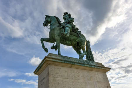 louis the rich heritage: Monument by Louis XIV in front of Versailles Palace. Palace Versailles was a royal chateau. It was added to UNESCO list of World Heritage Sites.
