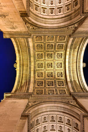 The Arc de Triomphe de lEtoile, (Triumphal Arch of the Star) is one of the most famous monuments in Paris, standing at the western end of the Champs-elysees at the center of Place Charles de Gaulle. Stock Photo
