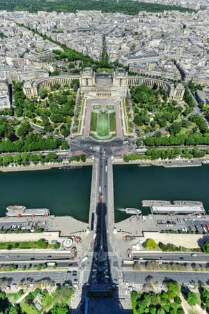 Aerial view of Trocadero as seen from the Eiffel Tower with La Defense in the background in Paris, France.