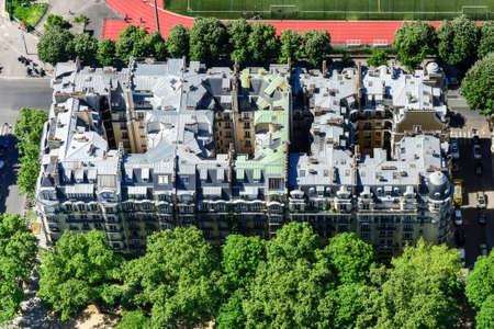 Aerial panoramic view of the roofs of Paris, France in the summer.