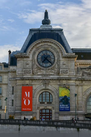 View of the wall clock in DOrsay Museum. DOrsay - a museum on left bank of Seine, it is housed in former Gare dOrsay in Paris, France.