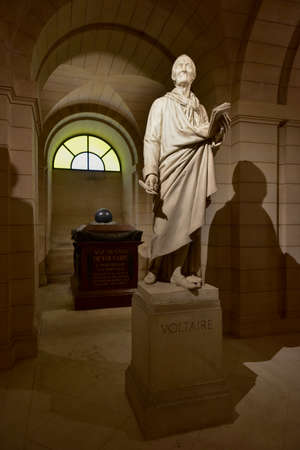 Paris, France - May 17, 2017: Voltaire tomb inside the crypts (underground) of French Mausoleum for Great People of France - the Pantheon in Paris, France. Editorial