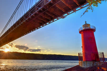 George Washington Bridge and the Red Little Lighthouse in Fort Washington Park, New York, NY in the evening. Stock Photo