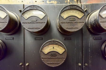 New York City - June 14, 2017: Vintage electrical meters, tracking direct current via analog displays. Stockfoto