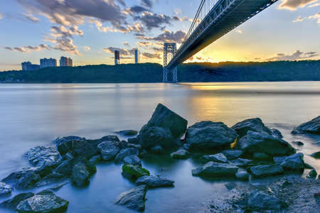 George Washington Bridge at sunset over the Hudson River from Manhattan. Stock Photo