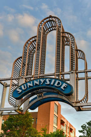 Sunnyside Arch in New York. Sunnyside is a middle-class and commercial neighborhood in the western portion of the New York City borough of Queens.