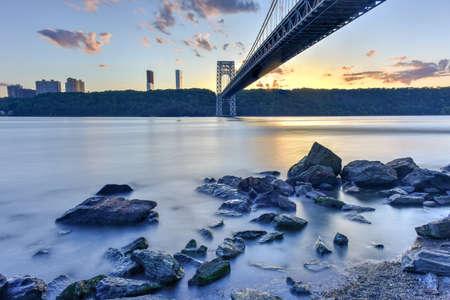 George Washington Bridge at sunset over the Hudson River from Manhattan. Stock Photo