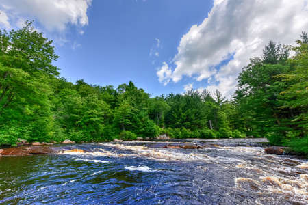 River flowing through the Adirondack River in by Cranberry Lake, New York. Stock Photo