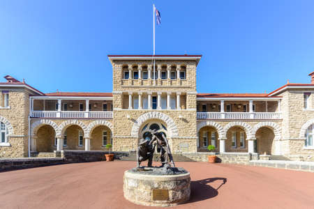 Perth Mint building, one of three branches as part of the Royal Australian Mint. Limestone building built in 1899. Facade with a statue of prospectors striking gold.