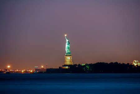 Statue of Liberty at night from Battery Park, New York City