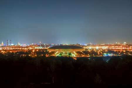 Aerial view of Luzhniki Stadium and complex from Sparrow Hills, Moscow, Russia at night.
