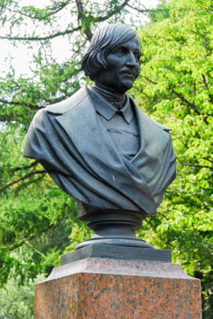 Monument to Nikolai Vasilievich Gogol (Ukrainian - Russian dramatist, novelist) in front of the Admiralty building in Saint Petersburg, Russia