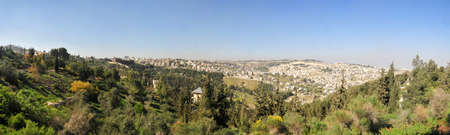 Panoramic view on white old Jerusalem. The Armon Hanatziv Promenade overlooks most of Jerusalem and offers a beautiful view of the city. Stock Photo