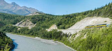 Alaska Railroad travels through Alaska on a bright summer day Stock Photo