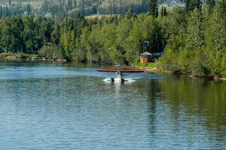 Seaplane landing on the water in Alaska