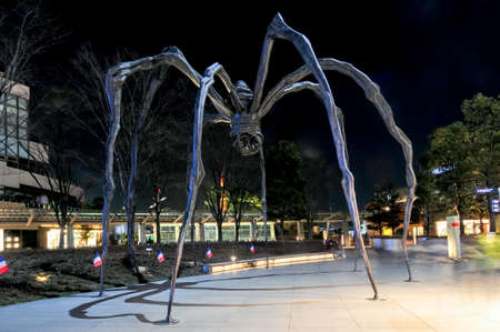 Tokyo, Japan - March 15, 2009: Maman - a spider sculpture by Louise Bourgeois, situated at the base of Mori Tower building in Roppongi Hills at night.