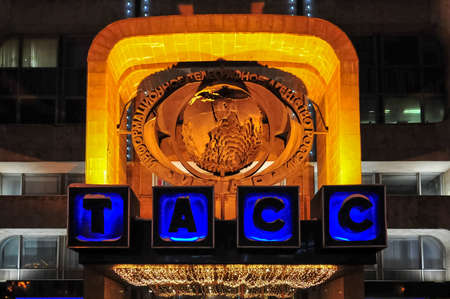 Sign to ITAR-TASS over the entrance to the building at night in Moscow, Russia.