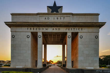 The Independence Arch of Independence Square of Accra, Ghana at sunset. Inscribed with the words