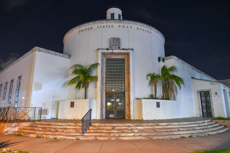 Art deco style United States Post Office building at night in Miami, Florida.