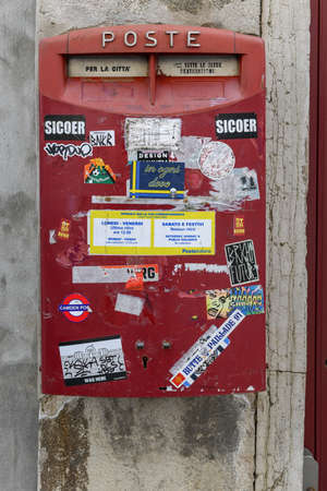 Red postal box for public use in Venice, Italy. Imagens