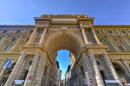 Florence, Italy - Mar 22, 2018: Triumphal Arch in Piazza della Republica Florence, Italy. Arch inscription says