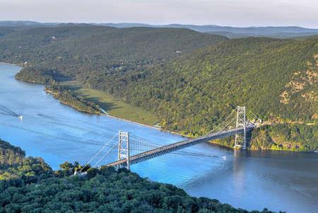 The Bear Mountain Bridge, ceremoniallynamed the Purple Heart Veterans Memorial Bridge, is a toll suspension bridge in New York State.