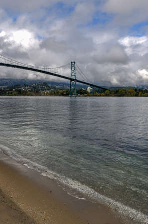 Lions Gate Bridge as seen from Stanley Park in  Vancouver, Canada. The Lions Gate Bridge, opened in 1938, officially known as the First Narrows Bridge, is a suspension bridge.