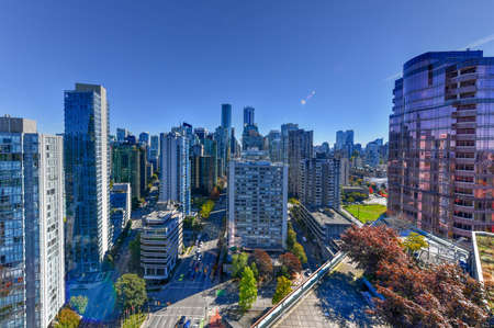 Aerial view of the modern city skyline of Vancouver, British Columbia, Canada during a sunny day. 스톡 콘텐츠