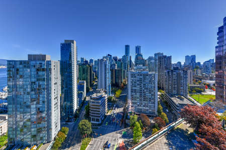 Aerial view of the modern city skyline of Vancouver, British Columbia, Canada during a sunny day. Editorial